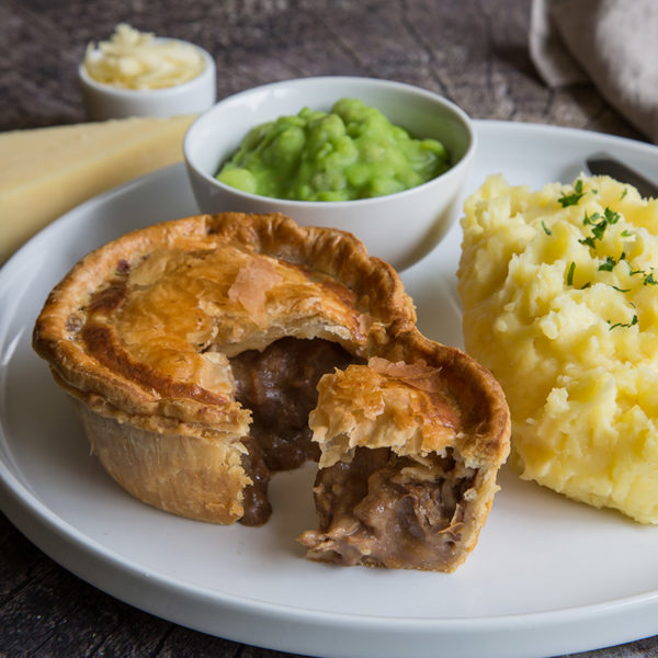 Steak pie with mash and peas